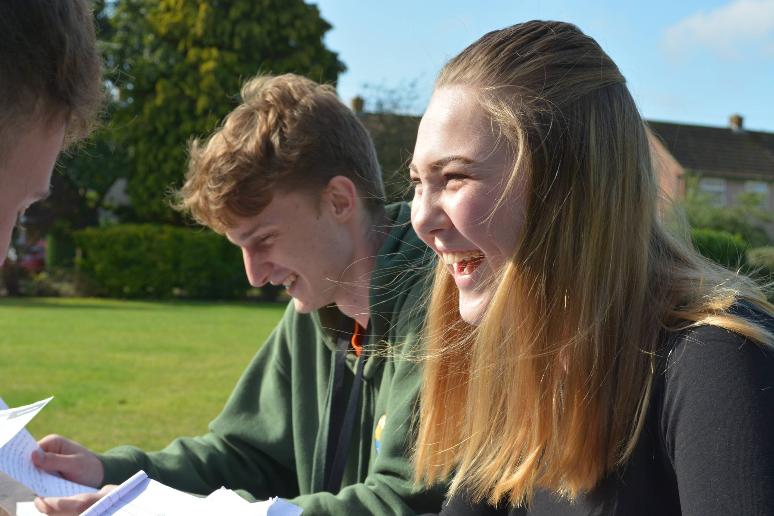 Sixth Form Students laughing outside