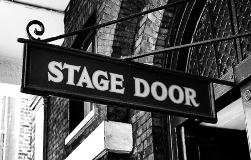 Stage door sign in black and white